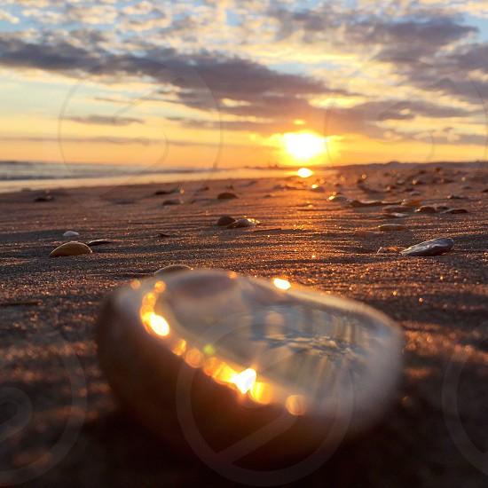 white stones on shoreline at sunrise photo