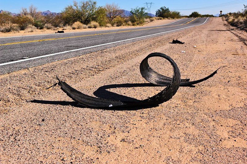 This is what happens to an under-inflated tire after running on a hot Arizona desert road in the summer. The rubber tread literally peeled off of the tire. photo