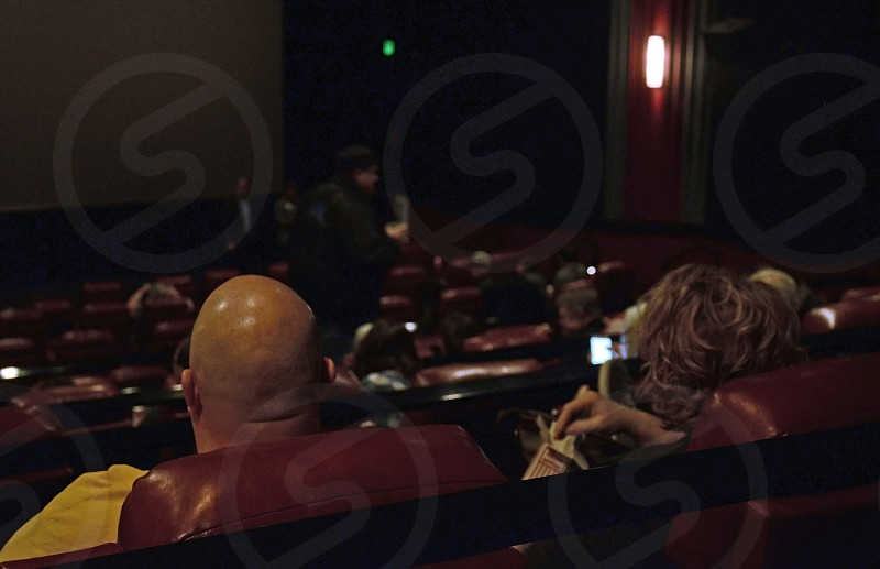 Audience seated in cinema watching film photo