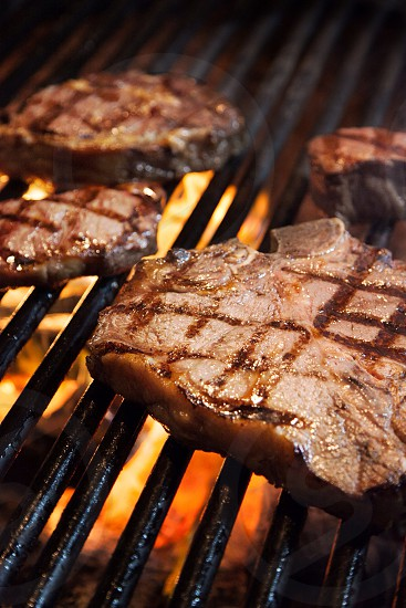 steaks on the grill photo