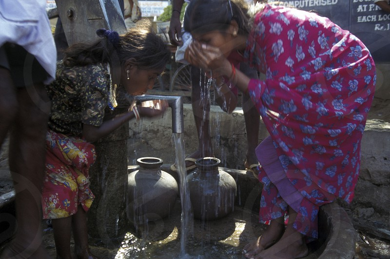 women at a water station in the province of Karnataka in India. photo