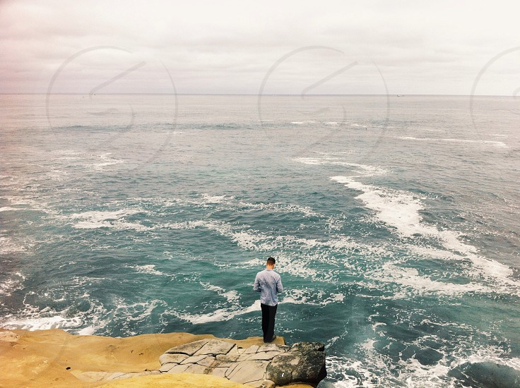 man in a cliff view photo