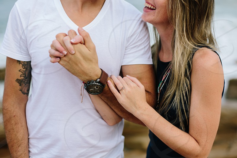 happy couple love smile hands tattoo sweet in love hold close embrace cuddle safe engaged engagement ring photo
