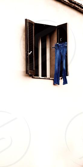 blue jeans. washing. italy. window. photo