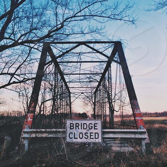 black white bridge closed sign photo