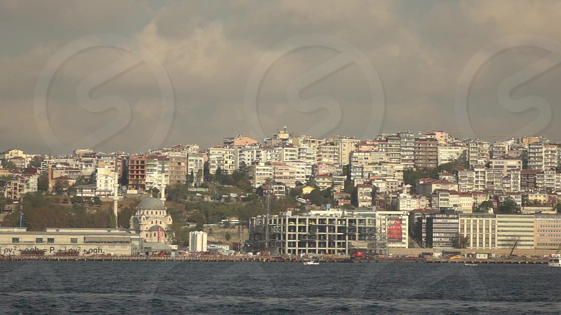Skyline panoramic view of contemporary side of Bosphorus in Istanbul Turkey in a summer sunny day . Slow motion Full HD video 240fps 1080p. photo