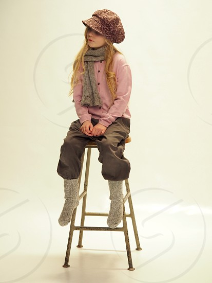 Photo shoot model hat old fashion young girl sitting chair socks one person smiling child kid daughter Sweden  photo