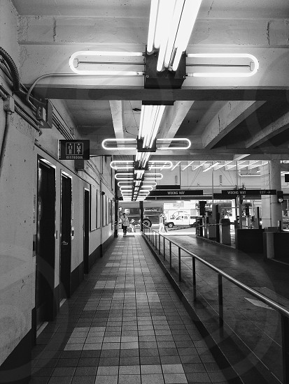 woman in white and black walking in subway photo