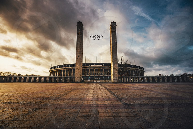 The majestic Olympiastadion of Berlin on a no-game day - originally built by the Nazis for the 1936 Summer Olympics this stadium still stands as one of the worlds most prestigious venues for sporting and entertainment events and offers close to 75.000 seats.  Today it is the home of the local soccer team Hertha BSC which I have yet to actually see in action - it seems I prefer having this place all to myself.  Made with Faded for iOS photo