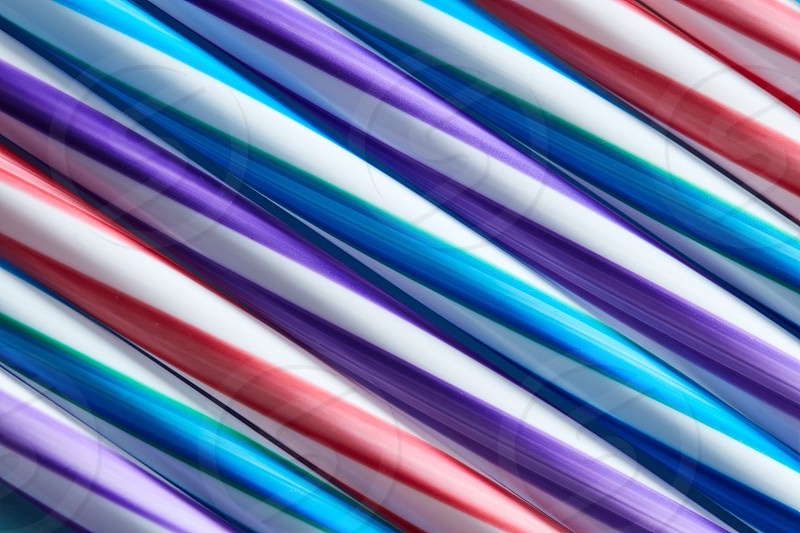 Multicolored plastic drinking straws top view. As a bright layout for your ideas photo