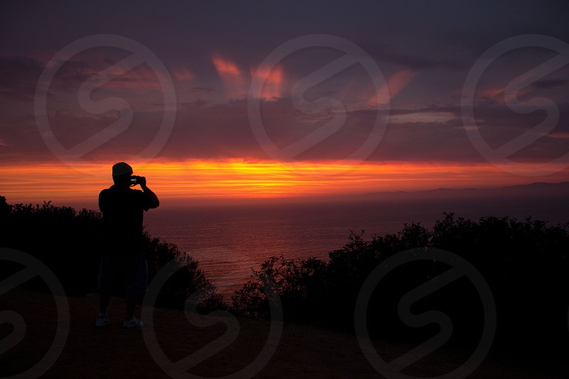Sunset over California with a photographer in silhouette.  photo