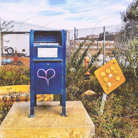 Mailbox with heart painted on it photo