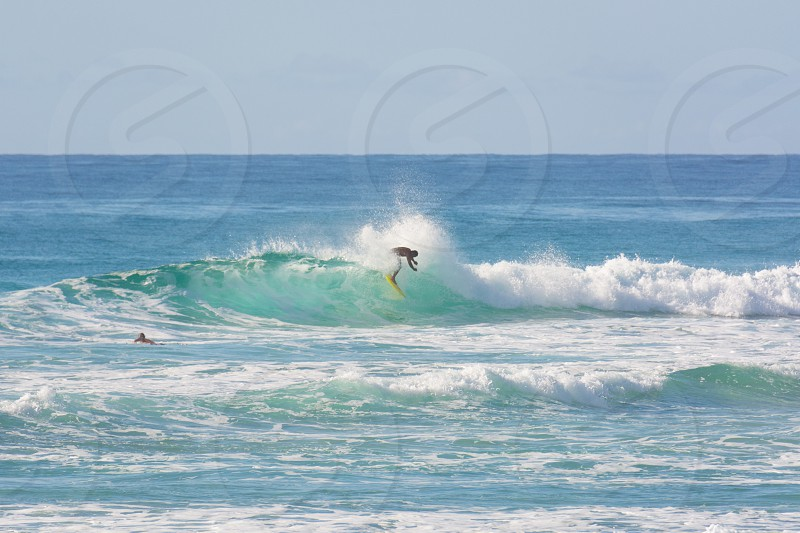 surfer surf surfing waves aqua clear water splash yellow surfboard tropical clear blue sky action sports photo