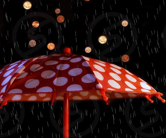 rainy day savings umbrella coins and rain photo