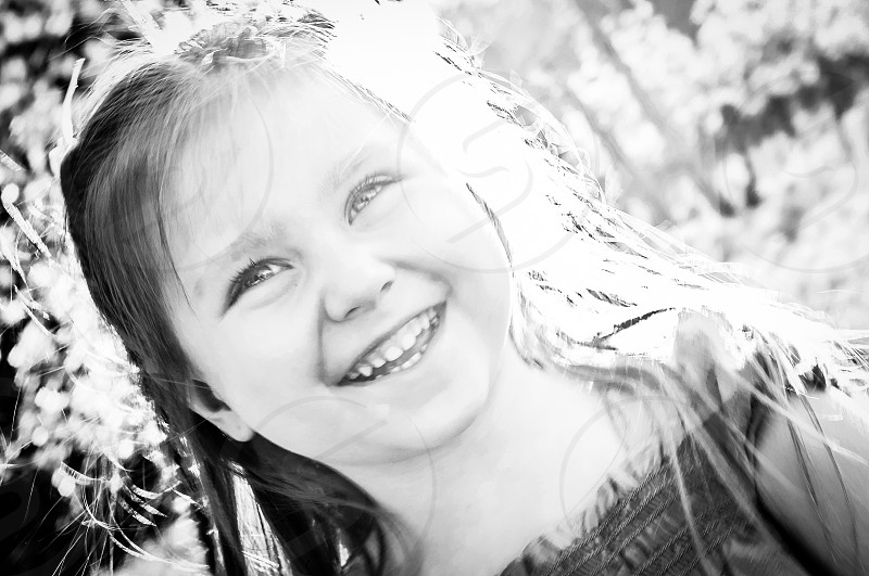 grey scale photo of a smiling girl photo