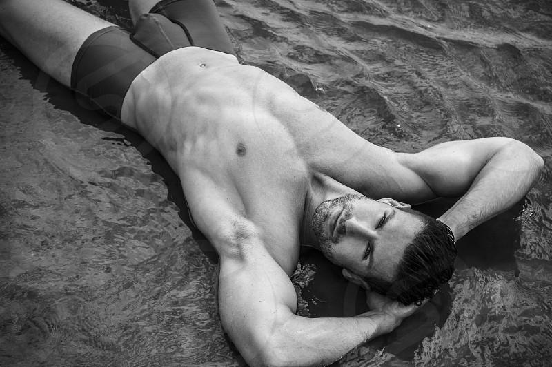 Handsome model in swimwear. photo