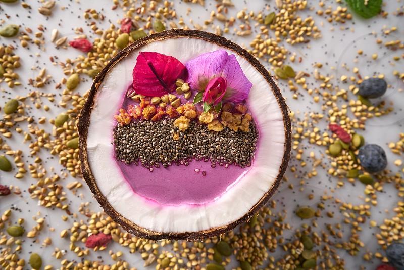 Acai bowl smoothie inside coconut chia granola blueberry and pitaya dragon fruit photo