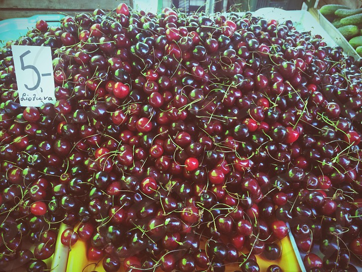 Market stall with cherries for sale in Liepaja Latvia photo