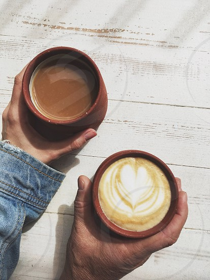 Two hands two coffee cups  photo