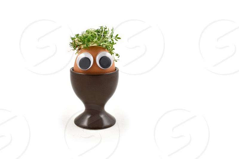 Egg with a face. Cheerful egg character. Funny Easter Egg. Easter egg with eyes. Easter eggs on a white background. Spring decoration images. Breakfast still life photo