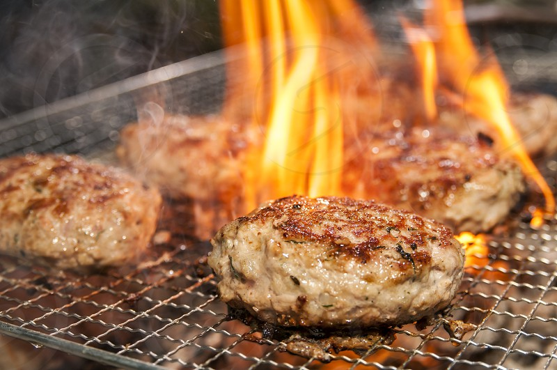 Closeup of pork burger patties barbecue on grill photo