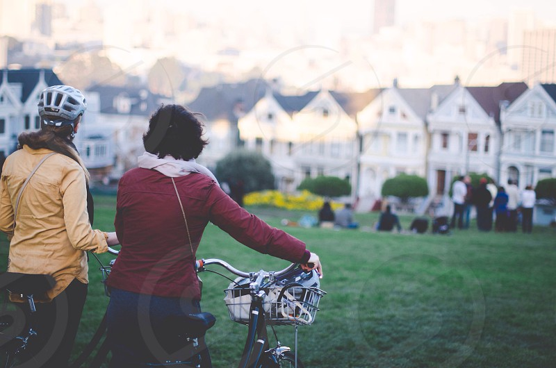 two person holding a bicycle  photo