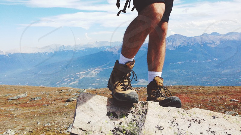 person in a brown and black hiking boots photo