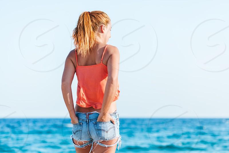 Sexy woman enjoying at the beach photo