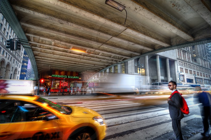 Traveler waiting on taxi outside Grand Central Terminal in NYC. photo