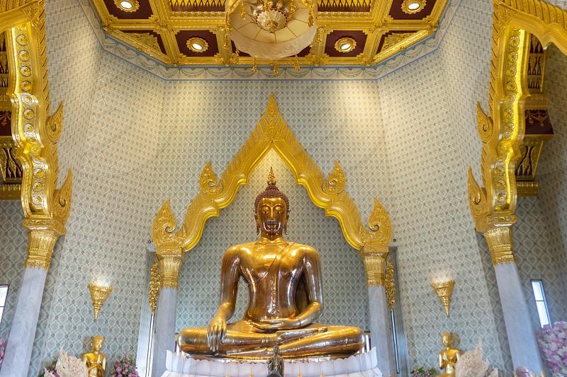 Buddha Statue in Traimit temple Bangkok Thailand. photo