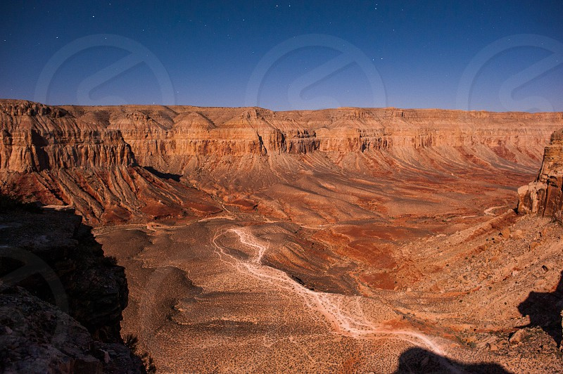 A portion of the Grand Canyon photographed from the canyon rim at night. photo
