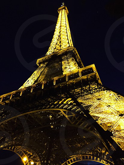 low angle photography of lighted eiffel tower during nighttime photo