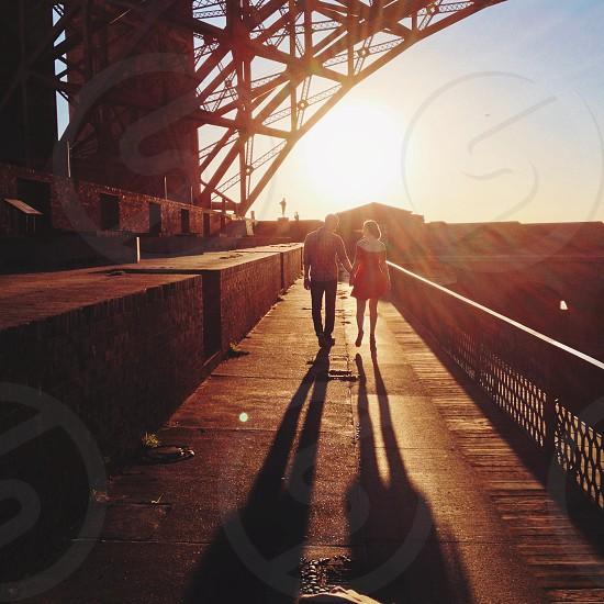 couple shadows on sideway railings with sun photography  photo