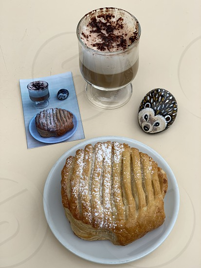Espresso coffee with milk with a bio pastry at the bar in Italy photo