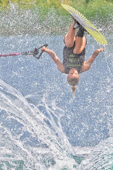 Wake boarding skiing water boarding water skiing flipping sports water pull line ponytail young girl competition  photo