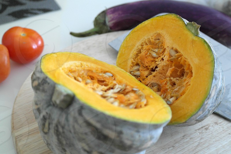 sliced squash beside eggplant and tomatoes photo