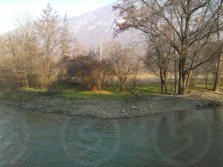 river and trees. located on radusa macedonia europe photo