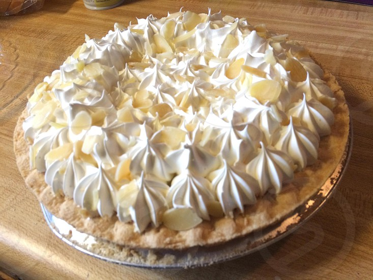 white meringue on brown pie photo