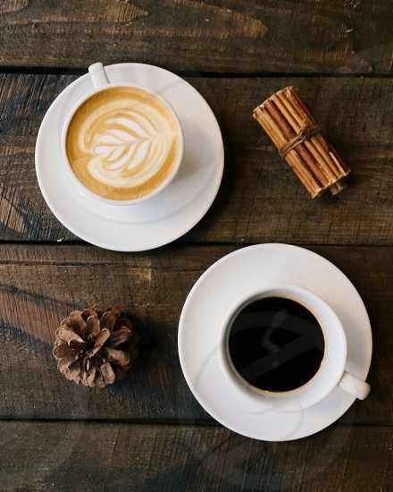 Two cups of coffee shot from above / Black coffee / Cappuccino photo