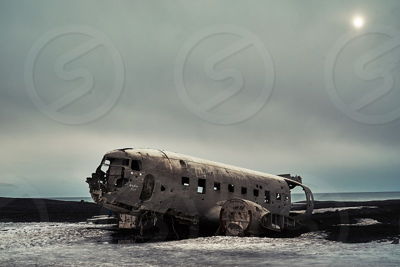 Crashed DC-3 in the black sand desert of Iceland. photo