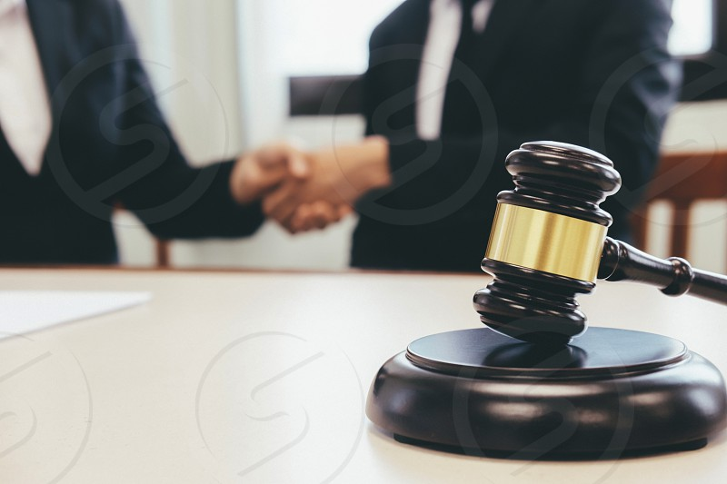 Law and Legal services concept. Lawyer and attorney having team meeting at law firm. Lawyer and businessman handshake. photo