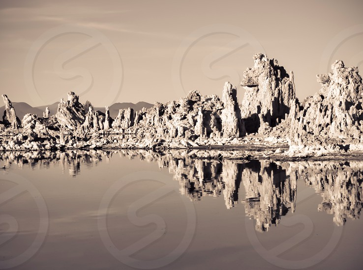 view of white rock formations near the waters photo