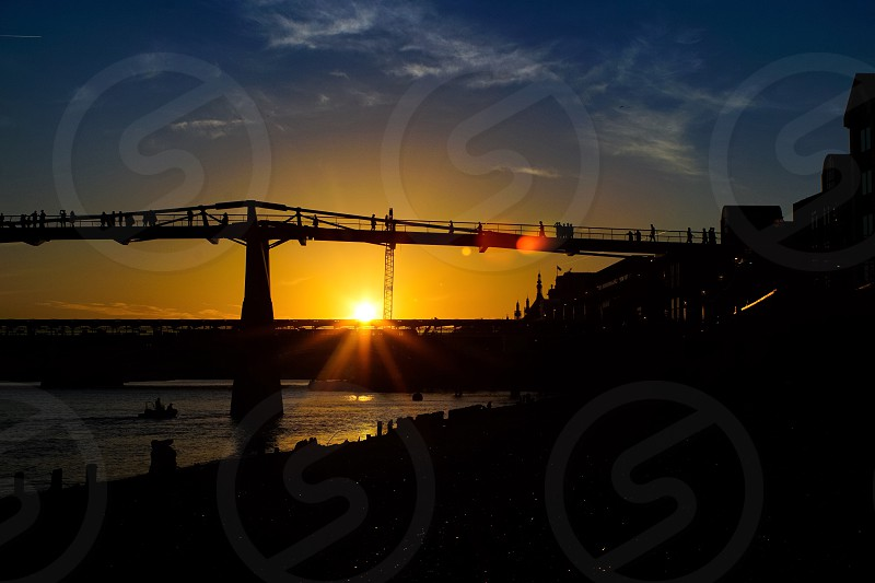 Sunset over the millennium bridge in London  photo