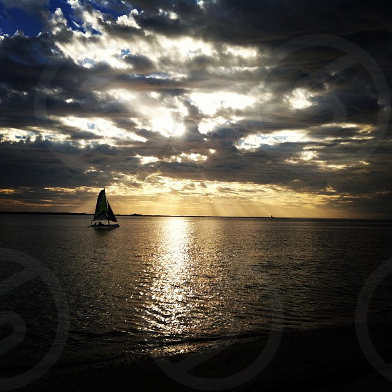sailboat on the water photo
