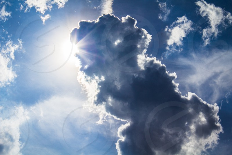 clouds sky looking up sun light rays abstract photo