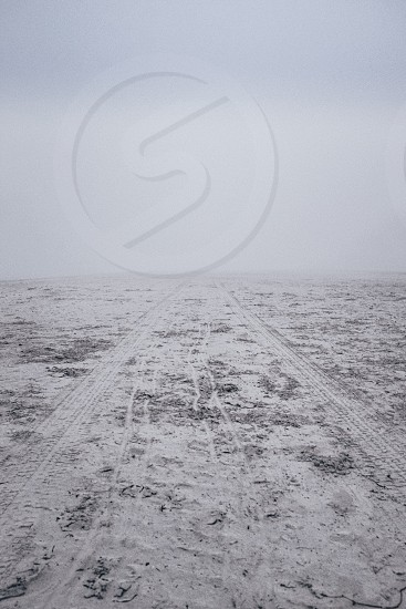 snow filled road view photo
