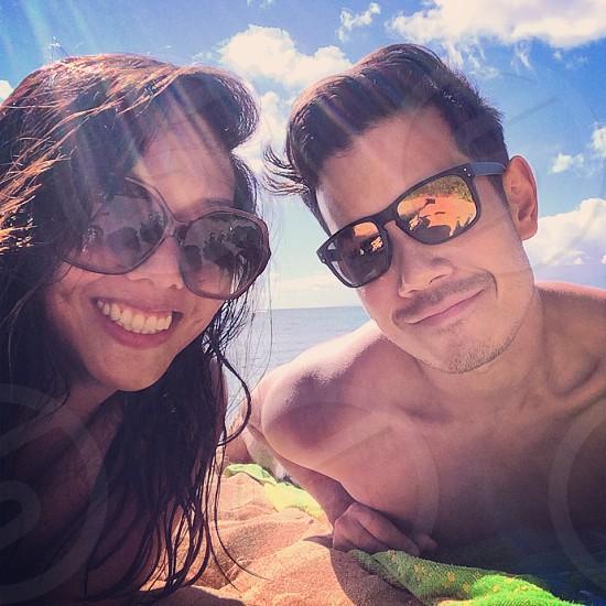 man and woman wearing sunglasses photo