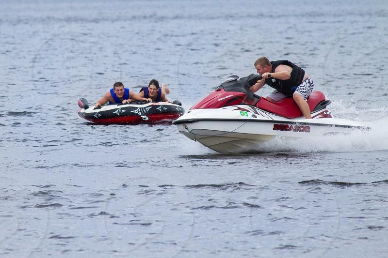Young men having fun at a lake photo