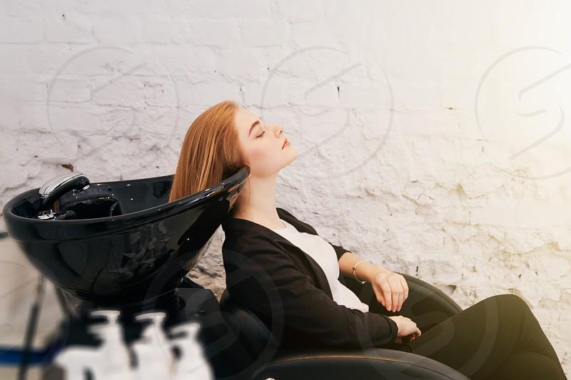 Girl washing her hair on hairdresser shop  photo
