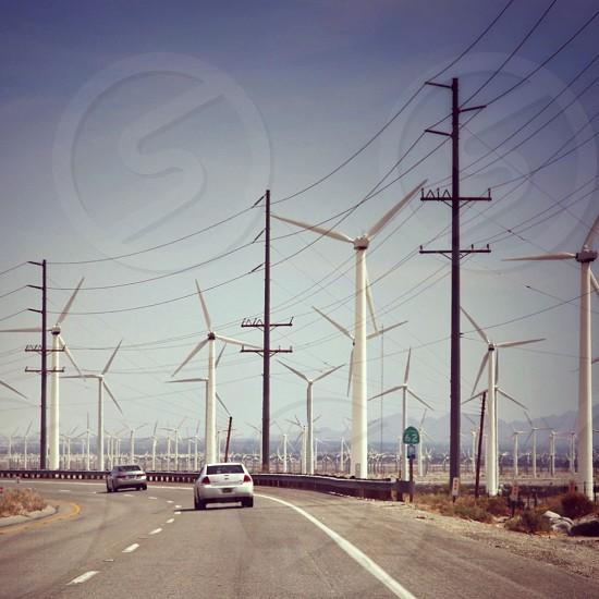 windmills near road photo